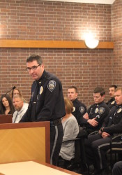 Police Chief Tim Schwartzkopf praises the performance of four of his officers and a dispatcher to the Prairie Village City Council.