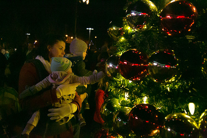 Youngsters explored the tree decorations after the lighting ceremony.