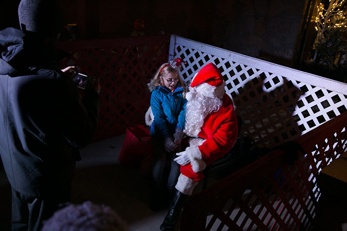 After helping light the tree, Santa fielded gift requests.