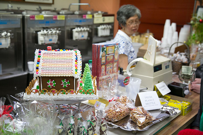 The Corinth merchants help open houses showing off their Christmas decorations, like Mely's intricate ginger bread houses.
