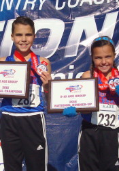Jack and Kate Lucas pose with their team trophies at the Cross Country Coaches National Championships in Evansville, Ind. (Contributed by Jean Lucas)