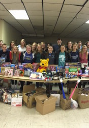 Members of the Shawnee Mission East Student Activity Advisory Council  delivered toys and gift cards to the Hope House Women's Shelter in Kansas City.