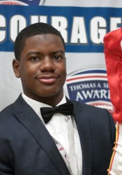Bishop Miege senior Jafar Armstrong poses with the Otis Taylor Award.