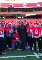 A few Bishop Miege football players and coach Jon Holmes pose for a picture with former NFL coach Steve Mariucci and Hall of Famer Michael Irvin. (via @coachjonholmes/Twitter)
