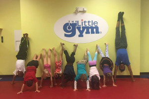 "Little Gym staff and students participating in ""Handstands Around the World"" in 2015. Photo via Facebook."