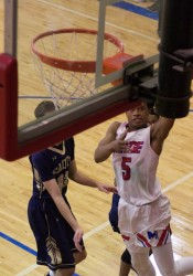 Bishop MIege's Ezekiel Lopes lays in two of his 10 points in the first half. He scored the first seven of the fourth quarter to help Miege climb back into the game after being down as many as 11.
