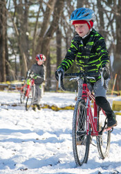 Young cyclists navigate the Jonas family's backyard cyclocross course in Overland Park.