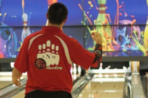 Shawnee Mission North's Travis Wunderlin gives a fist pump after rolling a strike. He finished fourth individually and helped the Indians to a second-place finish.