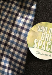North Leawood homeowners wore stickers showing their opposition to a request to rezone part of the old Leawood Country Club property on Tuesday.
