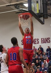 Bishop Miege senior Francesco Badocchi finishes a slam for two of his 18 points in the Stags' six-point win on Tuesday night.