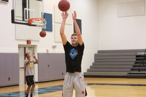 Shawnee Mission East's Liam George attempts a free throw while Kelyn Bolton rebounds behind him. George made 232 free throws in 20 minutes.