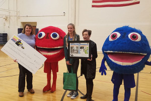 "Riley Peter found out she was the eighth grade winner of this year's ""Bag Your Favorite Book"" contest at an assembly last week."