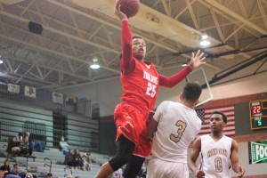 Shawnee Mission North sophomore Billy Conaway draws contact in the first half. Conaway led the Indians with 13 points.