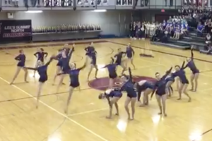 "Shawnee Mission East dance preforms to the Lumineers' ""Stubborn Love"" on Saturday at a competition at Lee's Summit North. (Screenshot from video tweeted by @SMEDrillTeam)"