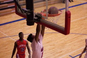 Bishop Miege sophomore Josh Earley dunks home two of his eight points in the Stags' 29-point victory.