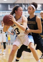 SM East's Josie Clough is fouled by SM West's Jheda Kennedy late in the game. Clough helped spur a 17-1 run in the third quarter.