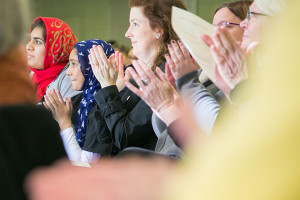 People from across the metro area came to the interfaith vigil in support of immigrants and refugees at Overland Park Christian Church Sunday.