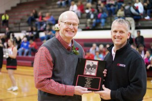SM North hall of fame inductee Mark Hantla, left, is presented his plaque by athletic director Ken Glaser.