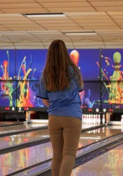 SM East senior Sydney Bass watches as her ball rolls down the lane in game two on Wednesday. Bass was the high bowler for the Lady Lancers with a three-game score of 412.