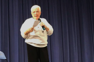 Jane Elliott on stage in the Shawnee Mission East auditorium Thursday night. Photo via Elliott on Facebook.